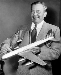 Donald-W.-Douglas-holding-a-prototype-model-of-the-DC-8-circa-1955
